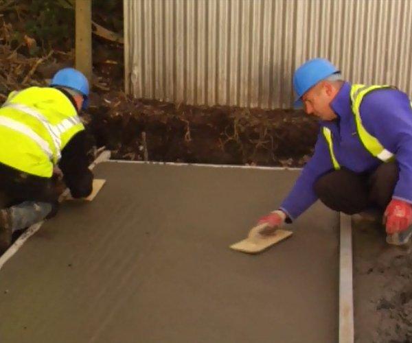 Concrete garage base laying