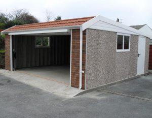 Pent mansard double concrete garages