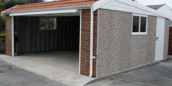 Pent mansard double concrete garages